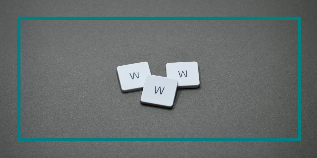 Three tiles on a grey background that say W. W. W.