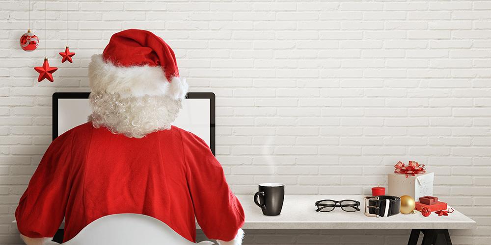 Santa sitting at a desk