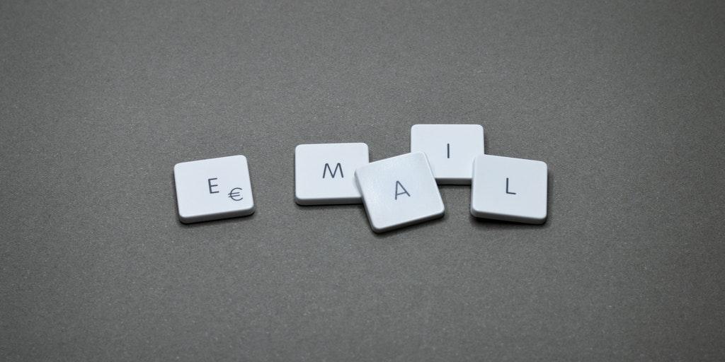 How to buy a domain email address - Letters on a grey background that spell out email.