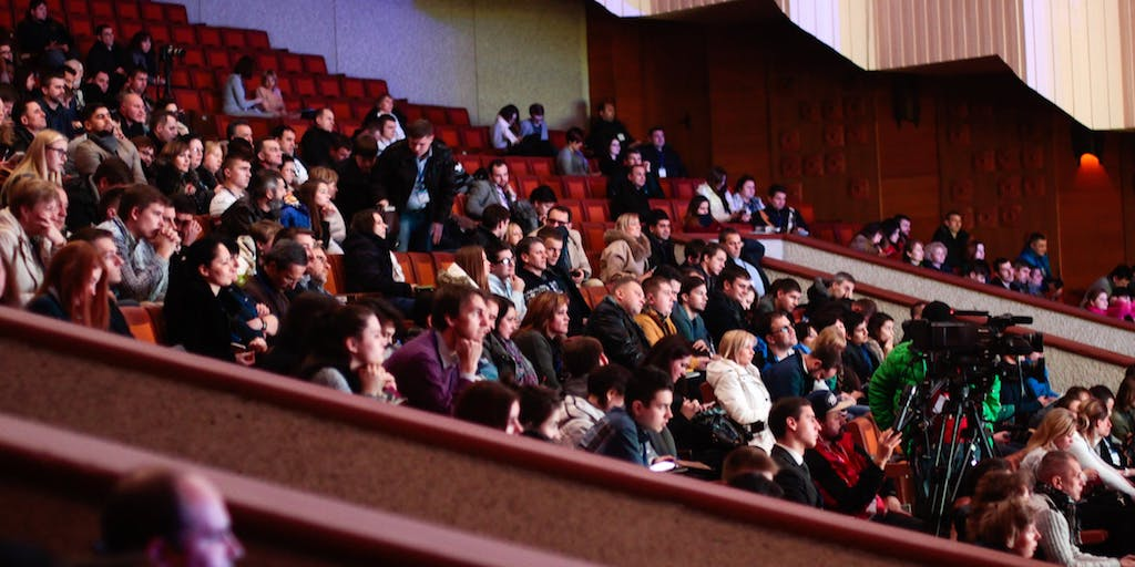 An audience is seated in an auditorium at a Toronto tech event