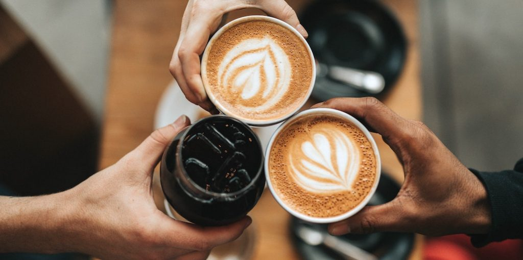 coffee shop domain names - trio holds coffee cups together