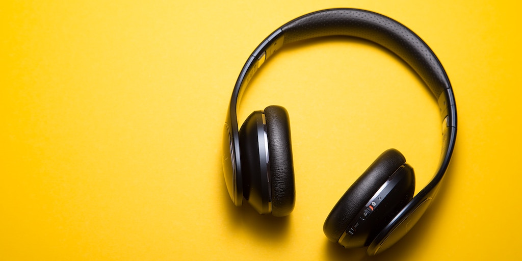 headphones resting on a yellow background