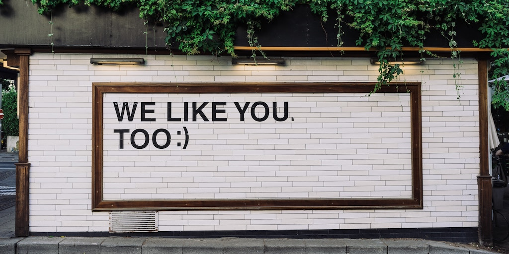 social media likes - sign says